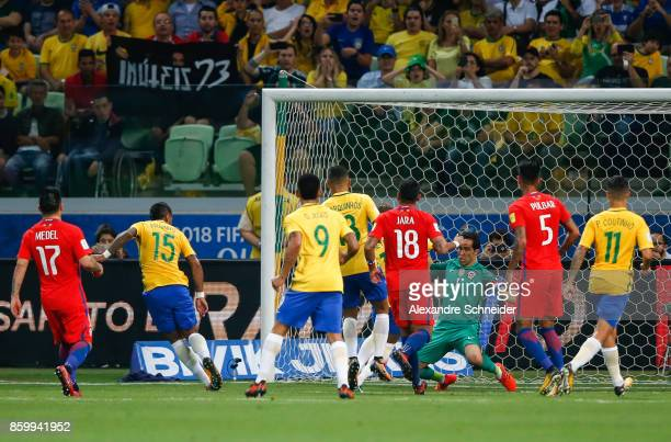 Paulinho of Brazil scores their first goal during the match between Brazil and Chile for the 2018 FIFA World Cup Russia Qualifier at Allianz Parque...