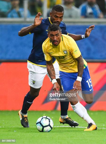 Paulinho of Brazil struggles for the ball with Gabriel Achilier of Ecuador during a match between Brazil and Ecuador as part of 2018 FIFA World Cup...