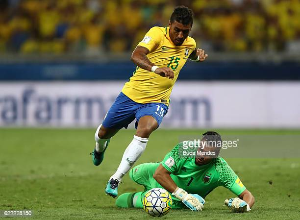 Paulinho of Brazil struggles for the ball with goalkeeper Sergio Romero of Argentina during a match between Brazil and Argentina as part of 2018 FIFA...