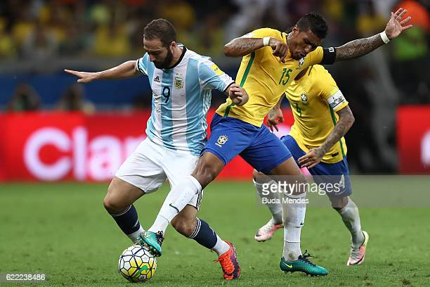 Paulinho of Brazil struggles for the ball with Gonzalo Higuain of Argentina during a match between Brazil and Argentina as part of 2018 FIFA World...