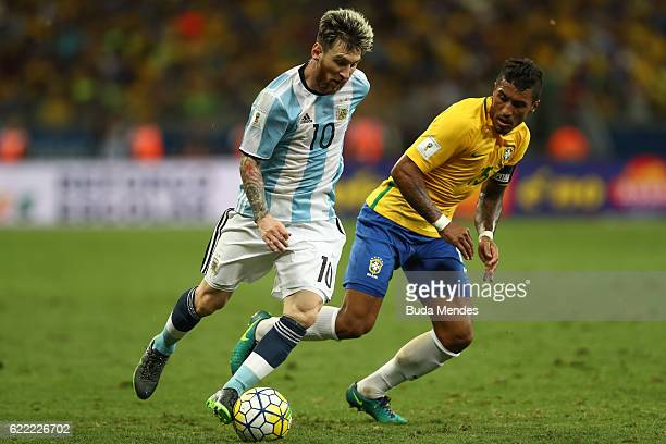 Paulinho of Brazil struggles for the ball with Lionel Messi of Argentina during a match between Brazil and Argentina as part of 2018 FIFA World Cup...
