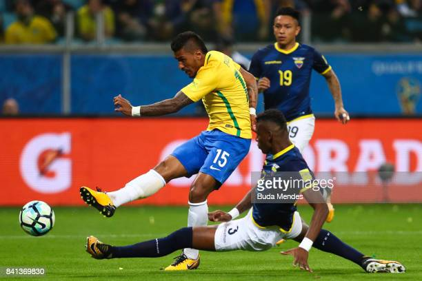 Paulinho of Brazil struggles for the ball with Robert Arboleda of Ecuador during a match between Brazil and Ecuador as part of 2018 FIFA World Cup...