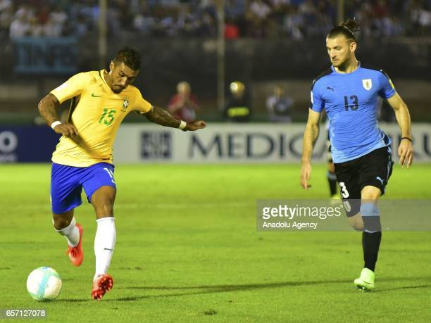 Paulinho of Brazil vies with Gaston Silva of Uruguay during FIFA 2018 World Cup Qualifiers match between Uruguay and Brazil at Centenario Stadium on...
