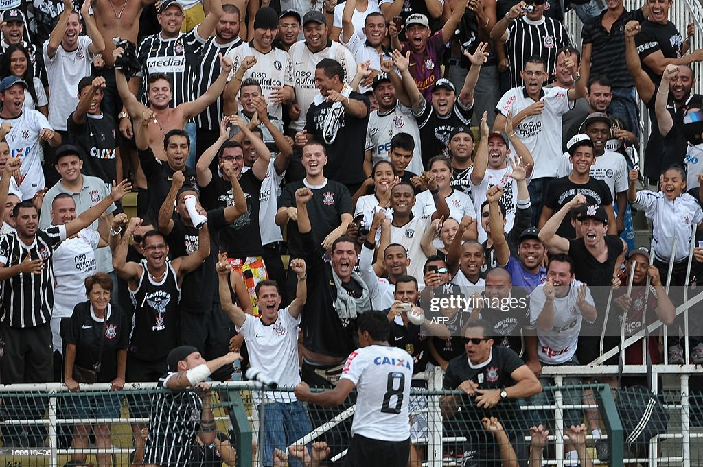 Paulinho of Corinthians celebrates with fans after scoring against Oeste, during their Paulista championship football match, at Pacaembu stadium in Sao Paulo, Brazil on February 3, 2013. AFP PHOTO/Yasuyoshi CHIBA