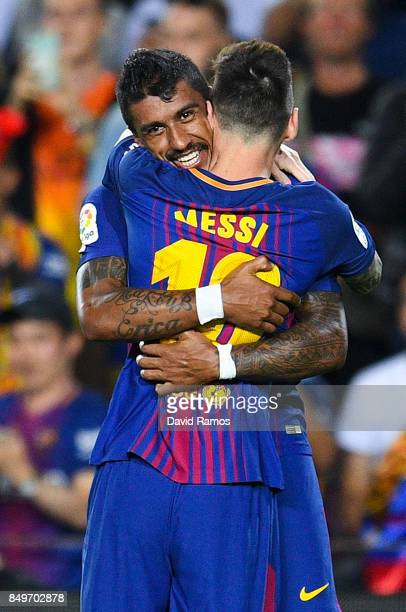 Paulinho of FC Barcelona celebrates with his team mate Lionel Messi after scoring his team's second goal during the La Liga match between Barcelona...