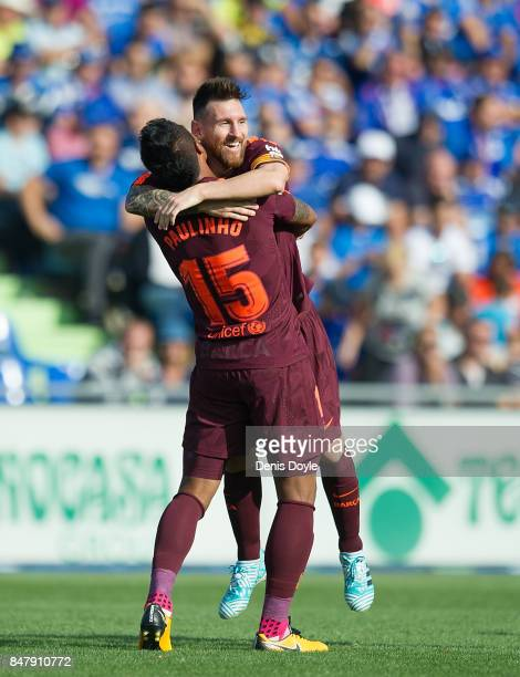 Paulinho of FC Barcelona celebrates with Lionel Messi after scoring his team's 2nd goal during the La Liga match between Getafe and Barcelona at...