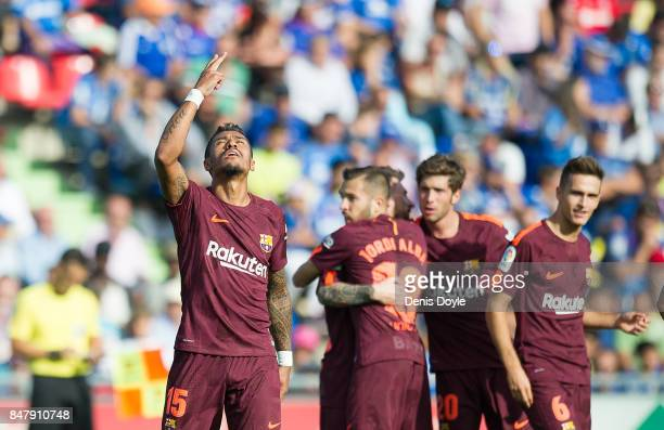 Paulinho of FC Barcelona celebrates with teammates after scoring his team's 2nd goal during the La Liga match between Getafe and Barcelona at...
