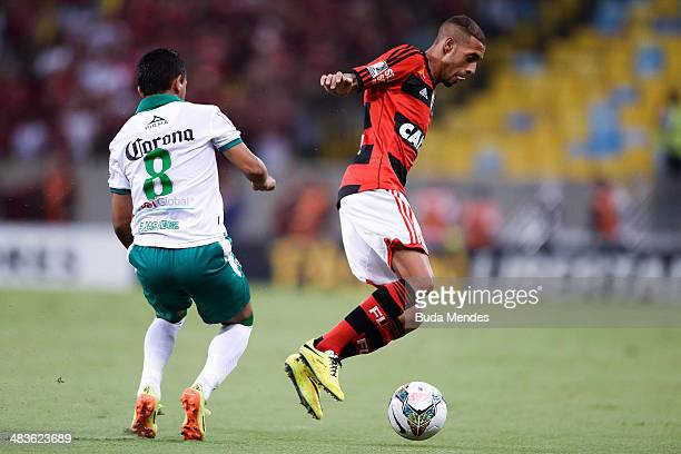 Paulinho of Flamengo battles for the ball against Elias Hernandez of Leon during a match between Flamengo and Leon as part of Copa Bridgestone...