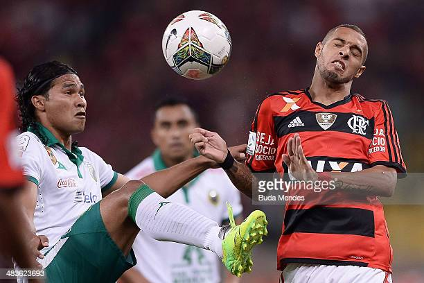 Paulinho of Flamengo battles for the ball against Pena of Leon during a match between Flamengo and Leon as part of Copa Bridgestone Libertadores 2014...