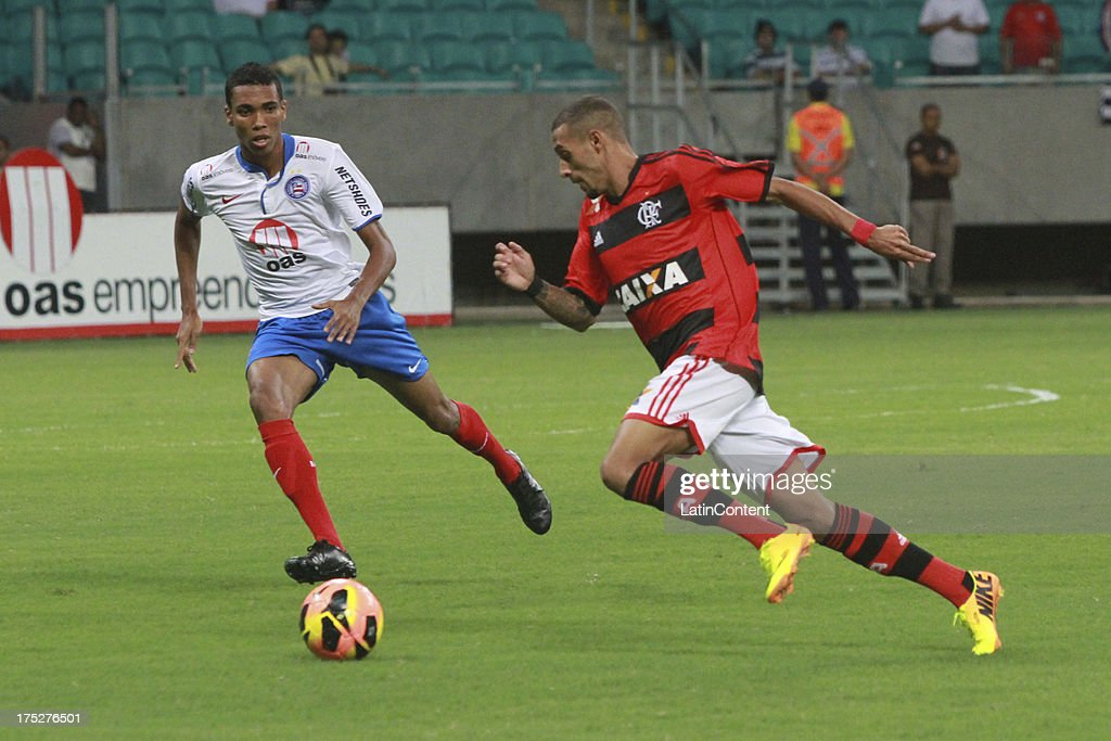 Paulinho of Flamengo competes for the ball with Madson of Bahia during a match between Flamengo and Bahia as part of the Brazilian Serie A Championship at Arena Fonte Nova Stadium on July 31, 2013 in Salvador, Brasil.