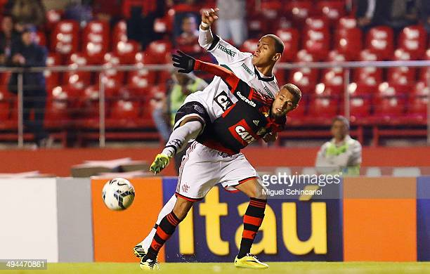 Paulinho of Flamengo fights for the ball with Leandro Silva of Figueirense during a match between Flamengo and Figueirense of Brasileirao Series A...