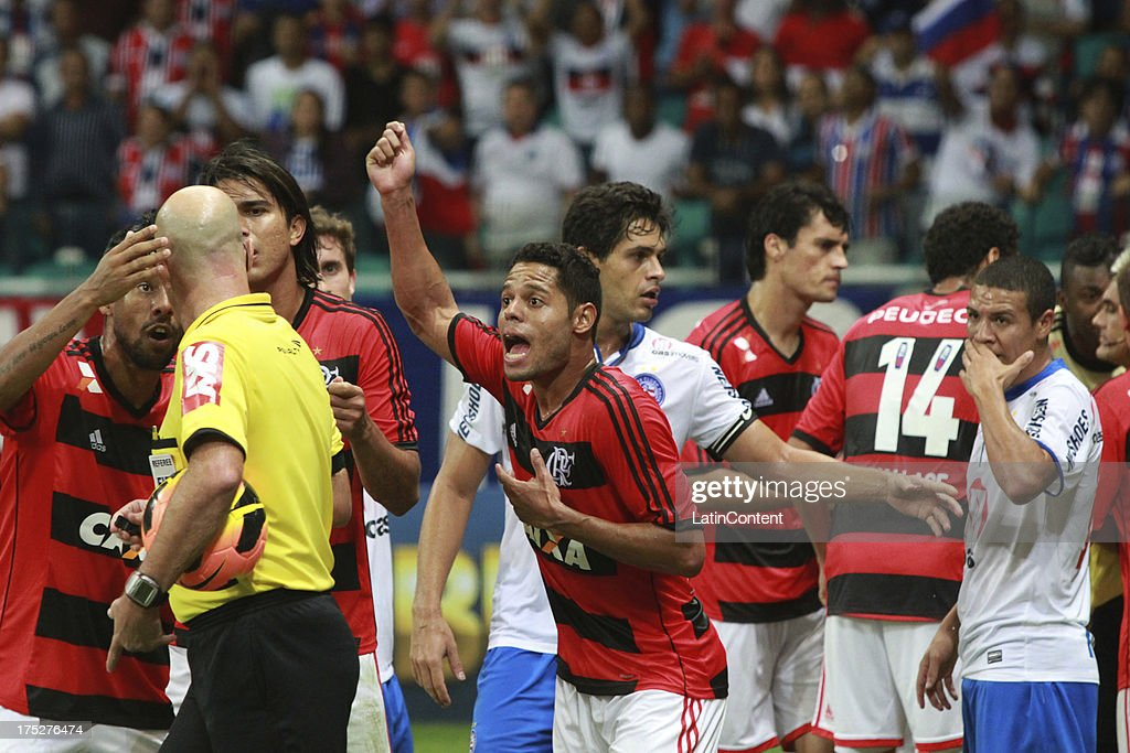 Paulinho of Flamengo reacts with the referee during a match between Flamengo and Bahia as part of the Brazilian Serie A Championship at Arena Fonte Nova Stadium on July 31, 2013 in Salvador, Brasil.