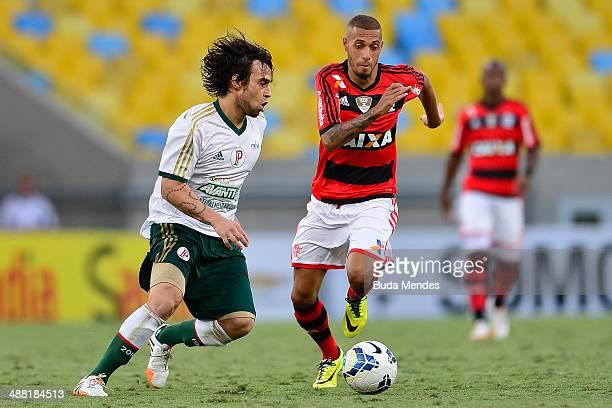 Paulinho of Flamengo struggles for the ball with Valdivia of Palmeiras during a match between Flamengo and Palmeiras as part of Brasileirao Series A...