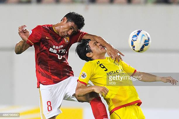 Paulinho of Guangzhou Evergrande and Masato Kudo of Kashiwa Reysol compete for the ball during the AFC Champions League quarterfinal football match...