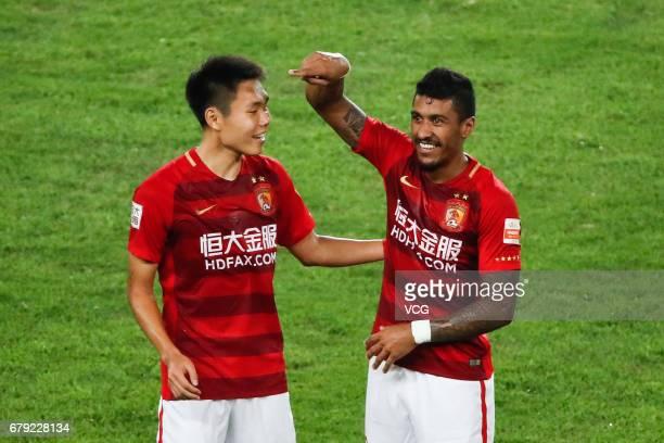 Paulinho of Guangzhou Evergrande and Wang Shangyuan of Guangzhou Evergrande celebrate a point during the eighth round match of 2017 Chinese Football...