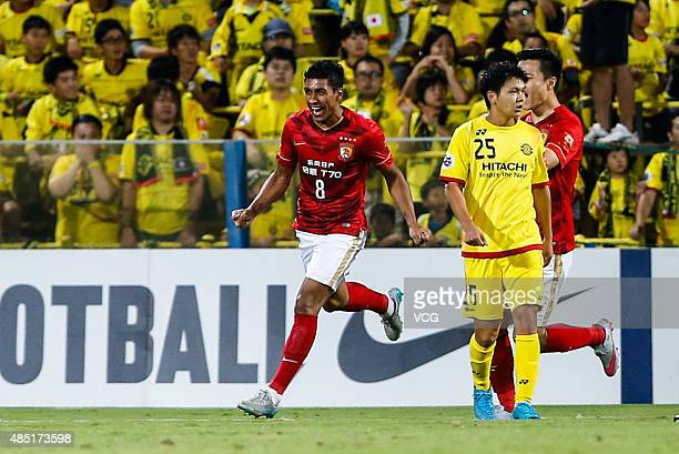 Paulinho of Guangzhou Evergrande celebrates after scoring his team's second goal during the AFC Champions League quarterfinal football match between...