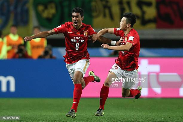 Paulinho of Guangzhou Evergrande celebrates after scoring his team's second goal during the FIFA Club World Cup quarter final between the Club...