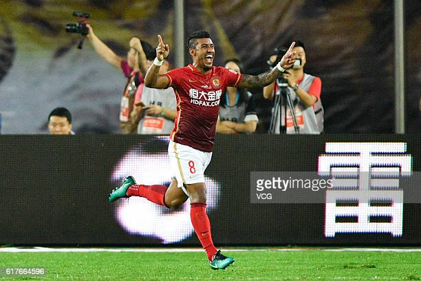 Paulinho of Guangzhou Evergrande celebrates after scoring his team's first goal during the 28th round match of CSL Chinese Football Association...