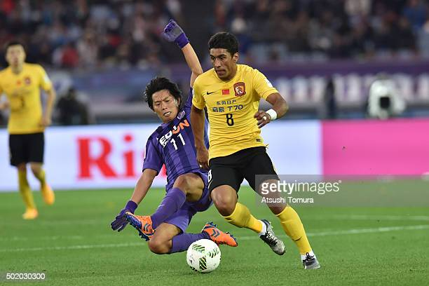 Paulinho of Guangzhou Evergrande FC and Hisato Sato of Sanfrecce Hiroshima compete for the ball during the 3rd place match between Sanfrecce...