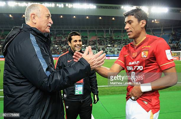 Paulinho of Guangzhou Evergrande FC celebrates his teams winwith manager Luiz Felipe Scolari after the FIFA Club World Cup quarter final between the...