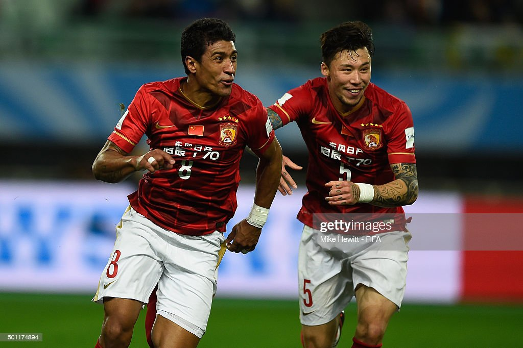 Paulinho of Guangzhou Evergrande FC celebrates with team mate Zhang Linpeng after scoring the winning goal during the FIFA Club World Cup Japan 2015...