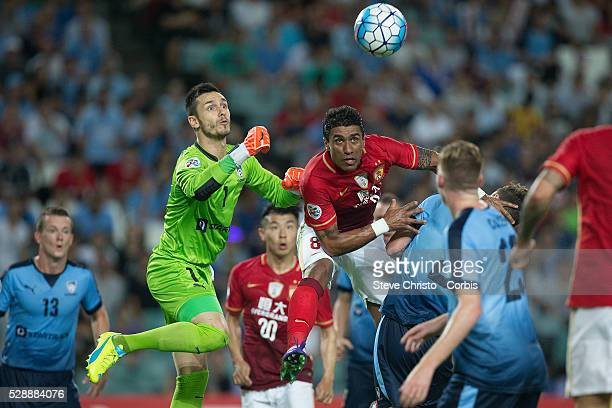Paulinho of Guangzhou Evergrande goes up for a header against Sydney FC's Vedran Janjetovic in the AFC Champions League match between Sydney FC and...