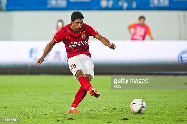 Paulinho of Guangzhou Evergrande scores the first penalty kick at the penalty shootout during the international friendly match between Guangzhou...