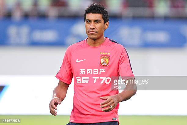 Paulinho of Guangzhou Evergrande warms up prior to the international friendly match between Guangzhou Evergrande and FC Bayern Muenchen of the...