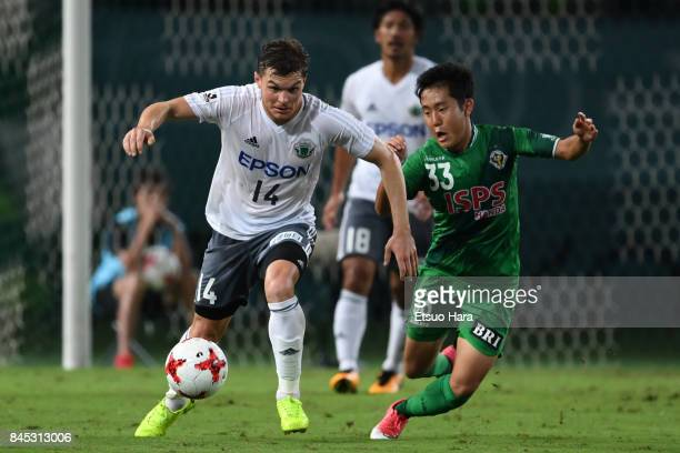 Paulinho of Matsumoto Yamaga and Kota Watanabe of Tokyo Verdy compete for the ball during the JLeague J2 match between Tokyo Verdy and Matsumoto...