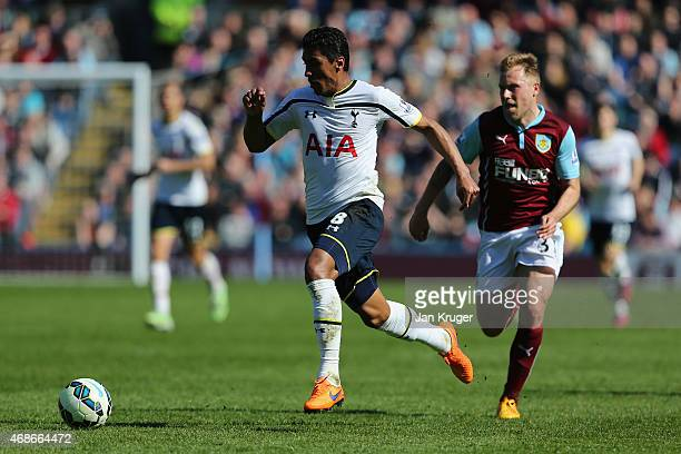 Paulinho of Spurs breaks clear of Scott Arfield of Burnley during the Barclays Premier League match between Burnley and Tottenham Hotspur at Turf...