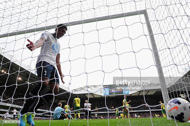 Paulinho of Spurs celebrates after Gylfi Sigurosson of Spurs scored the opening goal during the Barclays Premier League match between Tottenham...