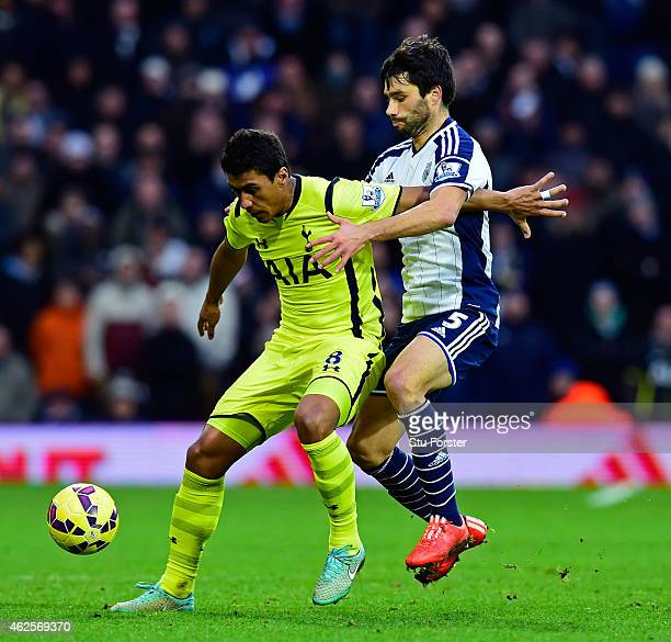 Paulinho of Spurs holds off the challenge Claudio Yacob of West Brom during the Barclays Premier League match between West Bromwich Albion and...