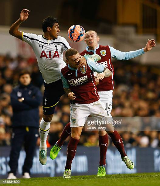 Paulinho of Spurs jumps with Kieran Trippier and David Jones of Burnley during the FA Cup Third Round Replay match between Tottenham Hotspur and...