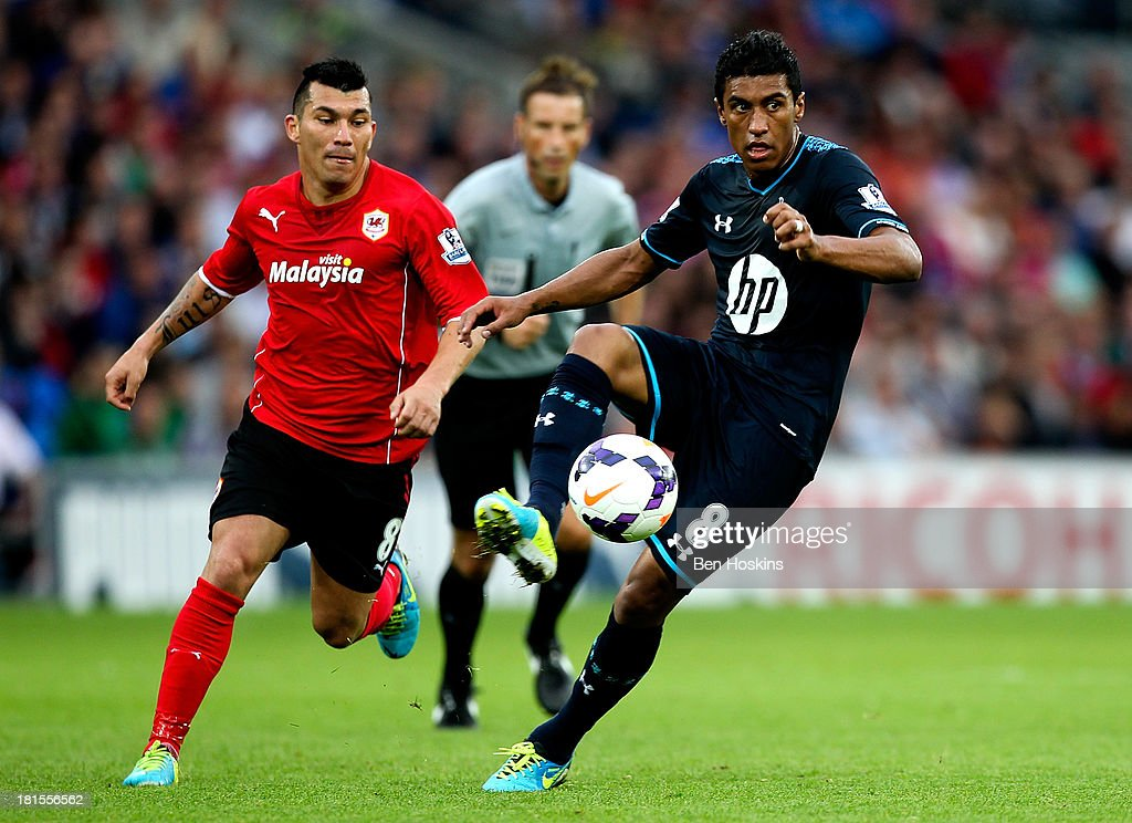 Paulinho of Tottengam looks to pass ahead of Gary Medel of Cardiff during the Barclays Premier League match between Cardiff City and Tottenham Hotspur at Cardiff City Stadium on September 22, 2013 in Cardiff, Wales.
