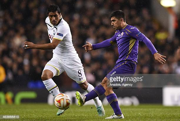 Paulinho of Tottenham Hotspur and David Pizarro of Fiorentina in action during the UEFA Europa League Round of 32 First Leg match between Tottenham...