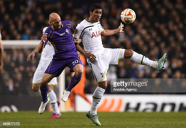 Paulinho of Tottenham Hotspur contests the ball with Borja Valero of Fiorentina during the UEFA Europa League Round of 32 First Leg match between...