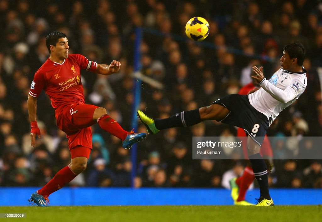 Paulinho of Tottenham Hotspur fouls Luis Suarez of Liverpool during the Barclays Premier League match between Tottenham Hotspur and Liverpool at White Hart Lane on December 15, 2013 in London, England.