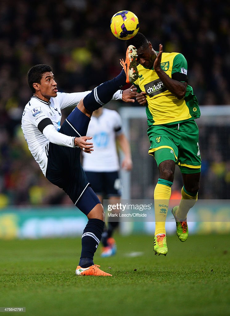 Paulinho of Tottenham Hotspur in action with Alexander Tettey of Norwich City during the Premier League match between Norwich and Tottenham Hotspur at Carrow Road on February 23, 2014 in Norwich , England.