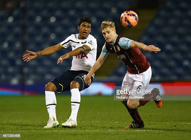Paulinho of Tottenham Hotspur is challenged by Ben Mee of Burnley during the FA Cup Third Round match between Burnley and Tottenham Hotspur at Turf...