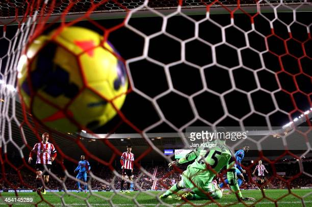 Paulinho of Tottenham shoots past Vito Mannone Goalkeeper of Sunderland for his goal during the Barclays Premier League match between Sunderland and...