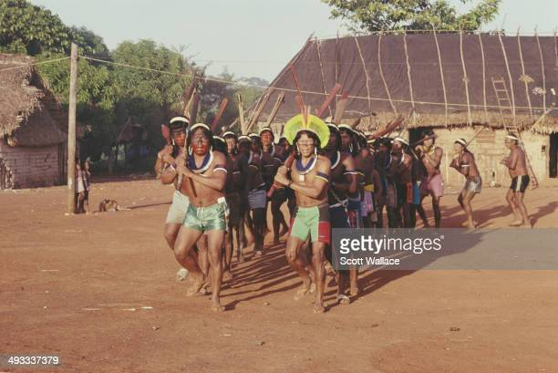 Paulinho Paiakan a leader of the Kayapo people takes part in a war dance in the Amazon Basin Brazil 1992