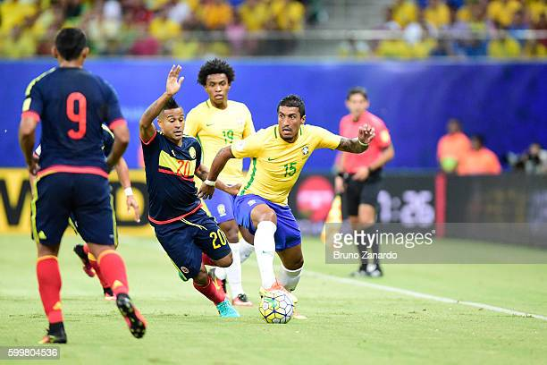 Paulinho player of Brazil competes for the ball with Player of Colombia during 2018 FIFA World Cup Russia qualification match between Brazil and...
