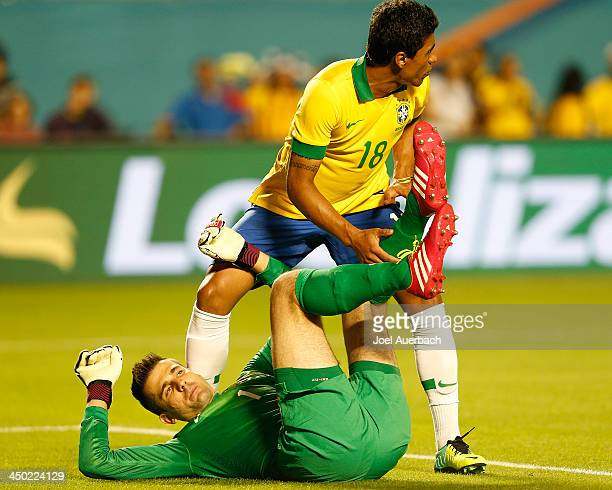 Paulinho watches for a shot on goal after Goalkeeper Victor of Brazil ends up on the ground after making a save against Honduras on November 16 2013...