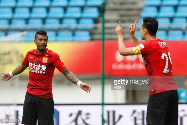 Paulinho#8 and Gao Lin of Guangzhou Evergrande communicate during the 13th round match of 2017 Chinese Football Association Super League between...