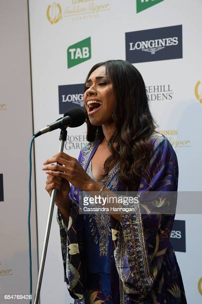 Paulini sings the National Anthem during Golden Slipper Day at Rosehill Gardens on March 18 2017 in Sydney Australia
