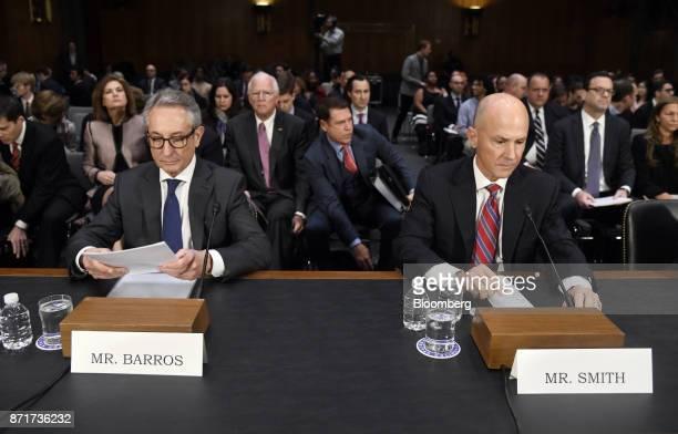 Paulino do Rego Barros interim chief executive officer of Equifax Inc left and Richard Smith former chief executive officer of Equifax Inc testify...