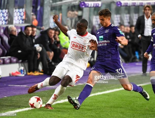 PaulJose Mpoku forward of Standard Liege and Leander Dendoncker midfielder of RSC Anderlecht during the Jupiler Pro League match between RSC...