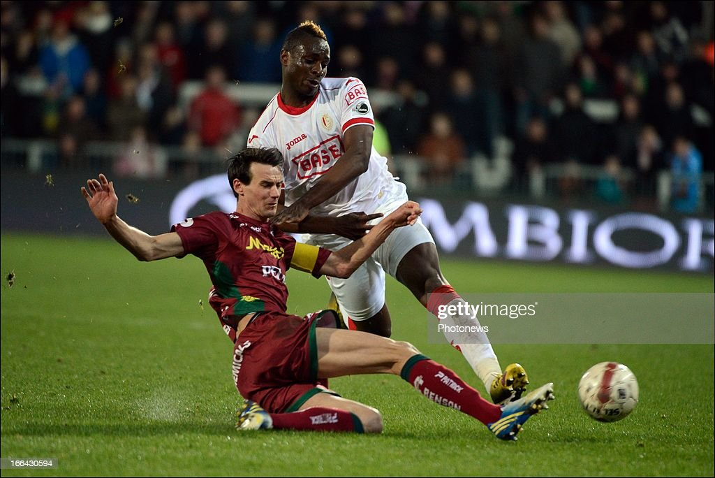 Paul-Jose Mpoku of Standard competes with Davy De Fauw of Zulte-Waregem during the Jupiler League match play-off 1 between Zulte Waregem and Standard de Liege on April 12, 2013 in Waregem, Belgium.