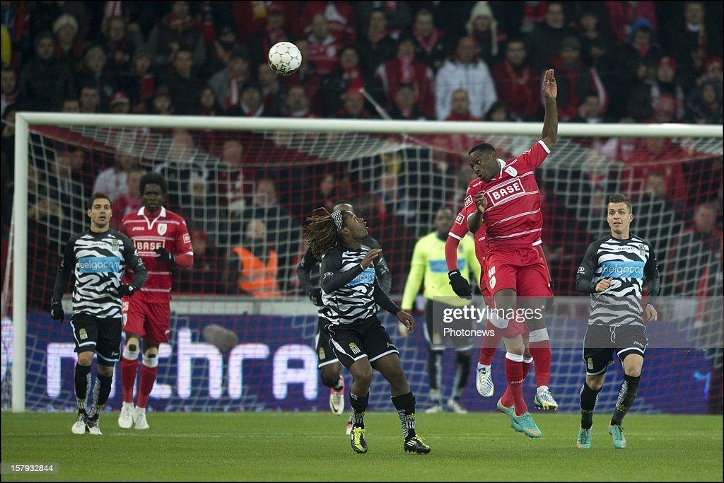Paul-Jose M'Poku (2nd R) of Standard de Liege wins the ball in the air during the Jupiler League match between Standard de Liege and Sporting Charleroi on December 7, 2012 in Liege, Belgium.