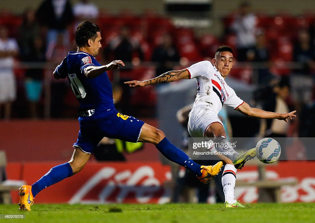 Paulo Andre of Cruzeiro and Centurion of Sao Paulo in action during the match between Sao Paulo and Cruzeiro for the Brazilian Series A 2015 at Morumbi stadium on July 26, 2015 in Sao Paulo, Brazil.
